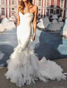 Gorgeous fitted and strapless dress. Find more like this at http://www.myweddingconcierge.com.au #weddings #weddingdress