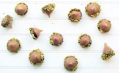 Luscious Paleo Coffee Meringue Acorns dipped in chocolate and speckled with pistachios are based on Martha's Coffee Meringue Acorns recipe.