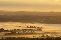 A slow September sunrises highlights mist in the air over the South Downs National Park. Great Britain, Photo Credit, Mists, National Parks, England, Autumn Colours, Clouds, Sunrises, Autumnal
