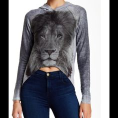 """Go Couture Hi-Lo Cropped Hoodie Tee !   Hi-Lo cropped hoodie tee ! """" Charcoal Lion Pride """" ! Attached hoodie ! Long sleeves ! Reverse seam detail ! Front print ! Approximately 15.5 inches front length ! 25 inches longest length ! Made in USA  This is adorable, one of a kind ! Love !  Go Couture Tops"""