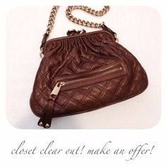"""Marc Jacobs Chestnut Little Stam This is one of MJ's most iconic styles and is no longer made. There is a front zip pocket, and the kiss-lock closure opens to a canvas lined interior with one zip pocket. Approx. 12""""W x 8""""H x 2""""D with a 12"""" strap drop. Gently used. Minimal hardware wear and the front zip still has the plastic on it. The interior lining has light wear and a few small marks. No major flaws.  ✅ OFFERS  SHIPS FAST    CLOSET TEMPORARILY CLOSING BY MAY - MAKE AN OFFER NOW…"""