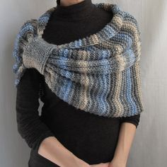 I hand knit this elegant wrap with yarn, which consists of wool 25% and acrylic 75%. Color: gray-blue-yellow. Please be aware that the colors in the