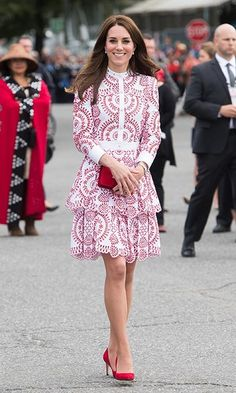 <h2>Day Two</h2><br>Kate greeted crowds in Vancouver wearing a custom red and white broderie anglaise Alexander McQueen dress. She further paid tribute to Canada's flag with matching red pumps and a small Miu Miu clutch.  <p>Photo: © Getty Images