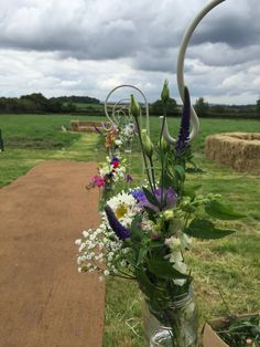 Create a stunning, rustic walkway with hessian, wild flowers in jam jars and some sturdy hooks. The arrangement is truly spectacular. www.effervescenceevents.com