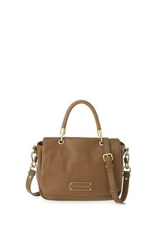 """A key Marc by Marc Jacobs accessory, the Too Hot to Handle Top Handle is a classic yet sophisticated leather tote bag, to complete any casual day or night time look. This shoulder bag features our modernized logo plaque detailing, magnetic closure, and a detachable cross-body strap for an alternate carrying option. 100% Cow Leather.13.75"""" x 3.25"""" x 10.25"""""""
