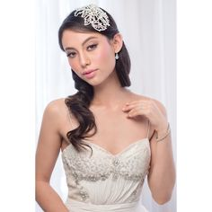 The Ornella Bridal Headpiece is extravagant and allows an individual to make a statement with this accessory.It is a moulded piece, so as to allow you to wear it on any part of your head without restriction.It has a duck bill clip attachment so that it enables more security when attaching it to your hair.The detail is balanced between ivory pearl, brilliant diamonte and light silver bugle beading.Measurement: 14.5cm long x 10cm at its widest point.This piece is presented in Roman
