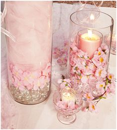 Wedding candles. Candle Cylinder Layering Technique:   Use thisquick and easy ideatoaddlayering in a large cylinder candle jar. Use clear marbles at the bottom and then add a layer of cherry blossoms and top it off with pink tulle.