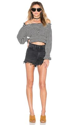 90e140f15e4e8 Shop for Norma Kamali Cropped Peasant Shirt in Black   White at REVOLVE.  Free day shipping and returns
