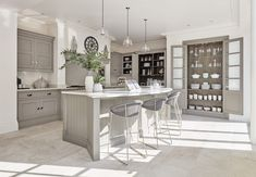 This stunning grey painted kitchen features a beautiful glazed pantry, Silestone worktops as well as Wolff, Westin and Neff appliances. Open Plan Kitchen, New Kitchen, Kitchen Decor, Kitchen Furniture, Shaker Style Kitchens, Home Kitchens, Shaker Kitchen, Tom Howley Kitchens, Grey Painted Kitchen
