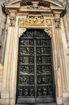 The Main Portal and the Creation of Eve sculpture to the Duomo di Milano