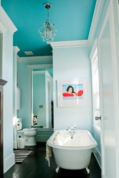 A contrast of blues with Benjamin Moore Peacock Blue (ceiling) and Icing on the Cake (walls)!