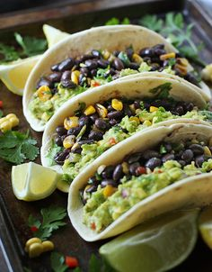 Veggie-loaded guacamole tacos with black beans, corn, and peppers.