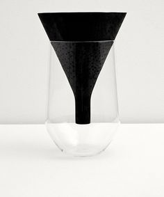 Carbonized carved oak wood, mouth blown glass by Formafantasma