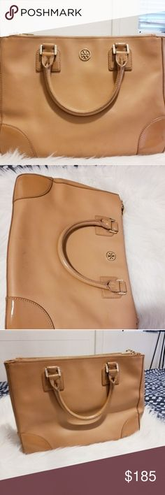 Tory Burch bag A great everyday bag that will give you compliments throughout the day. The bag  can fit so many things includes an 15inch MacBook.  Slightly used,so it is still in good condition. Lmk if you have any question. Thanks for interesting in my closet. Tory Burch Bags Crossbody Bags