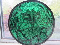 x 27 cm The image of The Green Man has been pained on a single piece of dark green glass and then fired in a kiln. The Green Man is enveloped in oak, ivy, mistletoe and hops. Green Man, Mistletoe, Single Piece, Dark, Glass, Image, Collection, Color, Drinkware