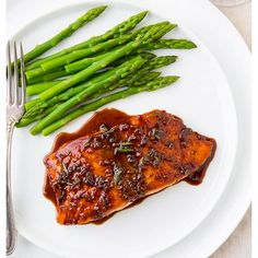 It's #FishFriday and we're nominating this yummy meal! Balsamic Glazed Salmon  Balsamic Rosemary Glaze  1/2 cup balsamic vinegar 1/4 cup White wine 2 Tbsp of honey 1 Tbsp djon mustard 1 Tbsp chopped fresh rosemary divided  1 cloves garlic finely minced  Salmon  4 (6 oz ) salmon fillets  Salt & pepper 2 tsp canola oil divided  #yummy #healthyliving #cleaneating #salmon by askmydoctortvstl
