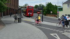 'Floating' bus stop (bus stop bypass) on a busy road in Brighton UK. Click to tweet via GB Cycle Embassy and visit the Slow Ottawa boards >> https://www.pinterest.com/slowottawa/