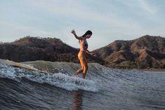 Josie Prendergast walking on water in the Love Louder Bikini Womens surf brand.Surf Bikini, Long Sleeve One Piece, Rash Guard, Surf Leggings and surfer girl clothing.Boho Fashion and Surfergirl streetwear Beach Pink, Beach Bum, Surfing Tattoo, Surfing Pictures, Summer Goals, Tropical Beaches, Surf Art, Burton Snowboards, Surf Style