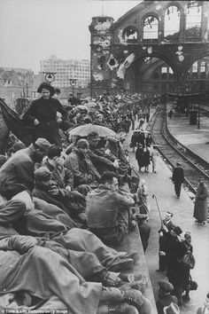 German refugees, civilians and soldiers, crowd platforms of the Berlin train station after being driven from Poland and Czechoslovakia following the defeat of Germany by Allied forces