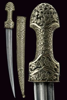Ottoman dagger, 18th century, slightly curved blade, hilt and scabbard entirely covered with silver foil embossed floral designs.