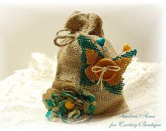 The Curtsey Boutique, burlap embellished bag with handmade kraft flower by designer, Andrea Amu.