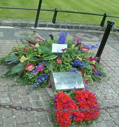 "Site of the scaffold of Anne Boleyn's execution, May 19th, 1536 - the Tower of London. Note the ""AB"" made from red roses."