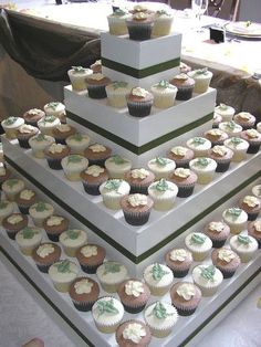 DIY cupcake stand made from decorated boxes. Very smart!