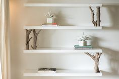 My floating driftwood shelves. High gloss with the driftwood and a wonderful contrast.