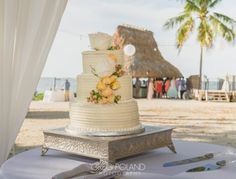 Beach wedding cake cheerful yellow accents and flowers decor At Key Largo Lighthouse Beach Wedding Venue in the Florida Keys Florida Keys Wedding, Florida Wedding Venues, Beach Wedding Reception, Wedding Reception Decorations, Key Largo Lighthouse, Conch House, Flower Decorations, Yellow Accents, Tropical Weddings
