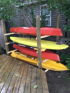 Kayak Storage Ideas Kayak, paddle board, paddles and small sailboat hull storage rack -- simple, sturdy, clean and out of the way. Diy Kayak Storage Rack, Kayak Rack, Boat Storage, Storage Ideas, Kayak Holder, Ladder Storage, Diy Storage, Kayak Paddle, Canoe And Kayak