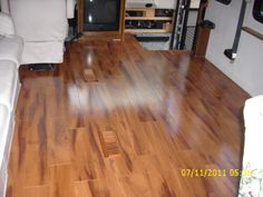 Motorhome - New wood floor in living room - also installed this in bedroom - love the vents!