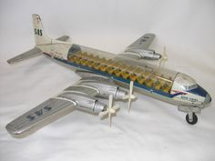 1950s Japanese tin toy model of a DC7 plane decorated with old SAS (Scandinavian Airlines) livery.
