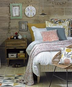 Snuggle down in a log-cabin-style bedroom. Make wood the material of choice for walls. Be sure to maintain its glorious facade with oil or wax. Bring to the fore woven and patterned cushions, throws and linens – a smart way to add autumn notes to neutral upholstery – while wooden accessories bring a balanced, organic feel to the room. Include leafy printed fabric and prints to reflect woodland foliage shapes and patterns.