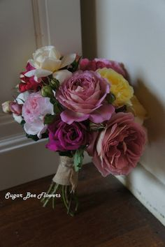 Old rose/ English rose / David Austin rose bouquet in pinks, creams, yellow, apricot and red.