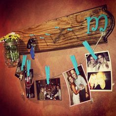 There is an old window pane with strings strung across the middle. Pin old family photos too it with close pins.