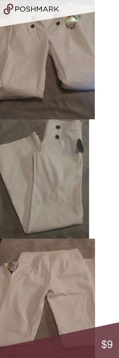 NWT Super cute designer pants. These are super cute and dressy and comfy size 9. HeartSoul Pants Boot Cut & Flare