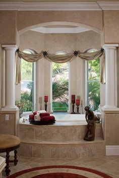 Great Idea to treat the bay windows as one large window and swag across all...
