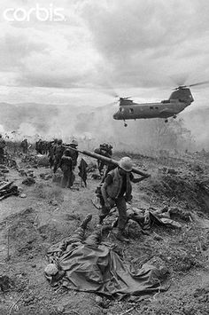 June 14, 1968, Khe Sanh, South Vietnam - A helicopter arrives at a hill near Khe Sanh to pick up soldiers killed and wounded when a US fighter plane accidentally fired upon a US position during the Vietnam War.