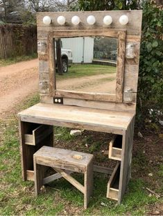 Rustic bedroom decor with brass mirror and greenery Wooden desk vanity boho