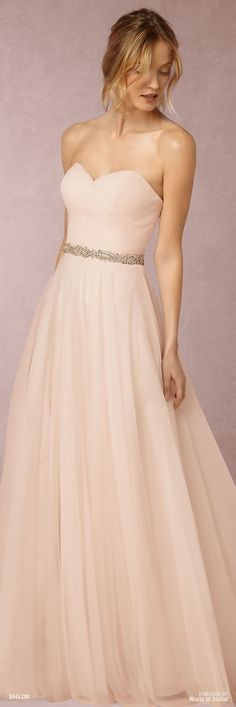 This gown is nothing if not fairytale-level romantic. Layers of porcelain pink tulle float over an ivory lining to create a rich, dreamy feel.
