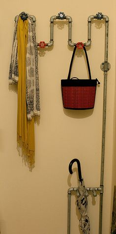 Plumbing pipes used as a coat rack.