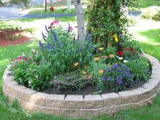 Retaining wall border bed. Very neatly done.