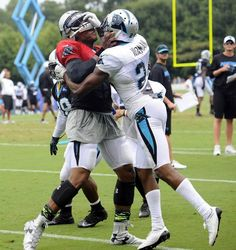 cc96ecd3d Carolina Panthers  Cam Newton and Josh Norman get into a skirmish in  practice during Carolina Panthers Training Camp at Wofford College in  Spartanburg