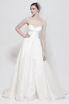 A-line taffeta sleeveless bridal gown. I really like the shape but it just needs a little something else
