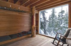 The 100-square-meter interior has two levels, including a sauna on the ground floor, and two bedrooms and den upstairs.