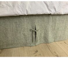The bed skirt is designed in chambray olive green linen fabric with ties at each pleat. Skirt hangs on three sides of bed, with complete separate on corners, to work with most bed frames. Headboard Cover, Linen Headboard, Green Bedding, Ruffle Bedding, Romantic Room, Romantic Homes, Oxygen Bleach, Bed Sizes, Fabric Swatches
