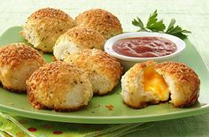 My family LOVED these.  I did cubes of white cheddar, Grands low fat buttermilk biscuit, skipped the butter and seasonings and just dusted them with parmesan on top.  Served with a side of cream gravy for breakfast.  They went nuts.