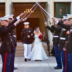 Sweet bride marrying her uniformed beau before the 4th of July.
