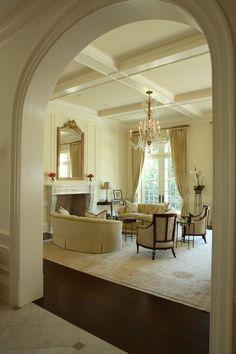 creamy trim, mega high ceilings, dark floors. Tone on tone creams, but actual furniture too formal for my tastes.