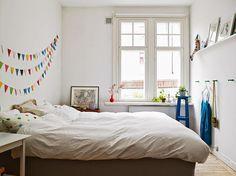 Un pequeño apartamento divertido y con toques de color #hogarhabitissimo #dormitorio